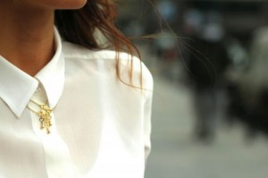 buttoned up white blouse with necklace on top