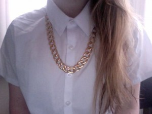 chunky necklace on buttoned up blouse