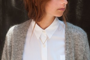 gabriela artigas small necklace on buttoned up white blouse
