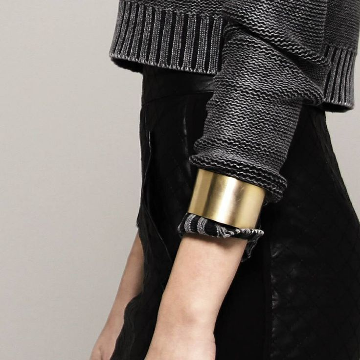 Cuff bracelet on jumper