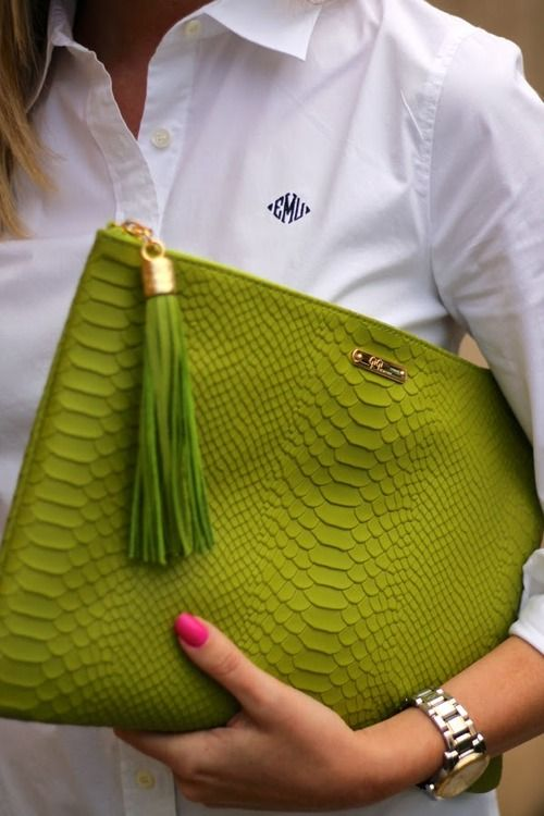 Pink nails on green bag detail