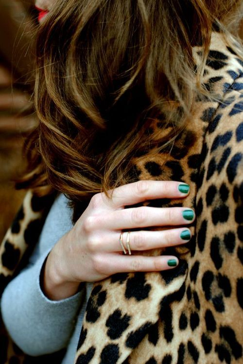 green nails on leopard detail