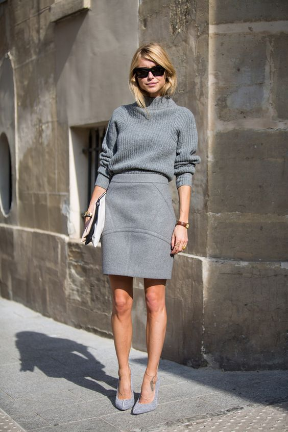 Oversized sweater tucked into pencil skirt, worn with